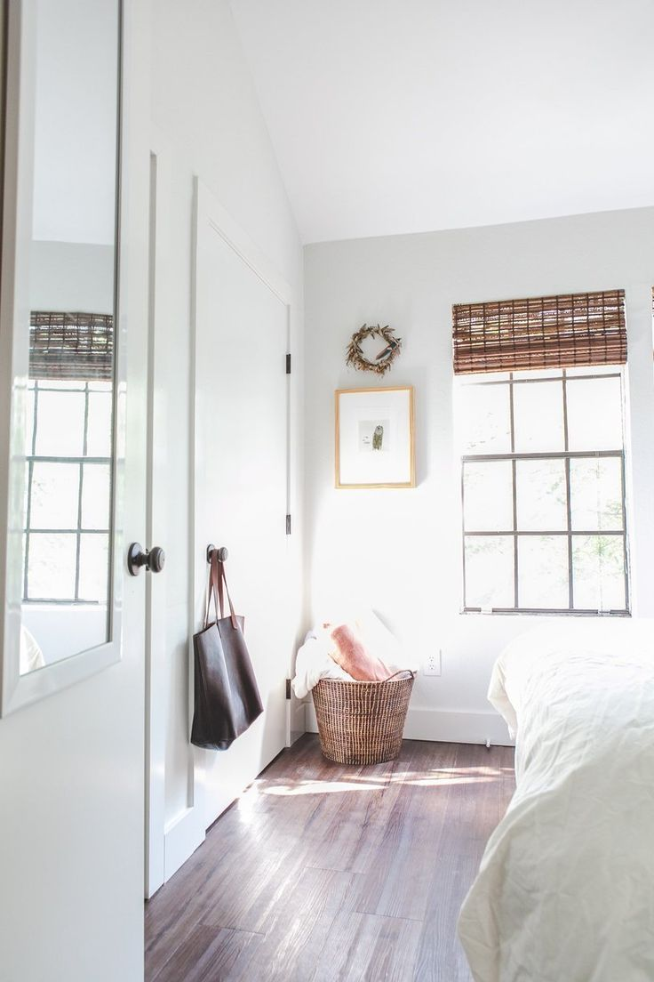 easy styling - basket on floor, cute print above. Also love the bamboo blinds.