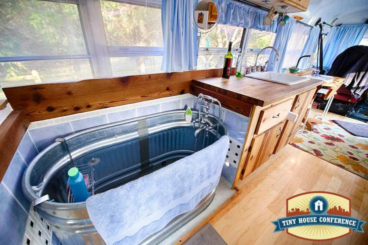 Soaker tub in a bus conversion.  Made from a farm water trough at the tinyhouseconference.com