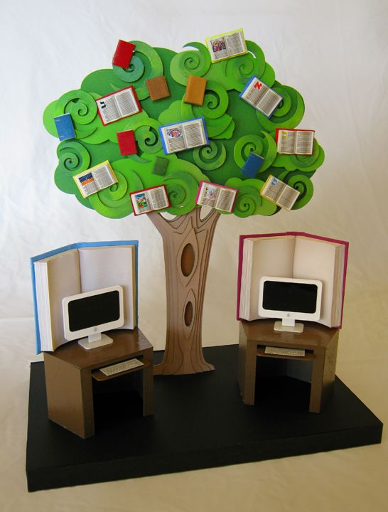 Tree whose fruit is books as the central decor element in the computer area of the Levi Yitzchak Children's Library