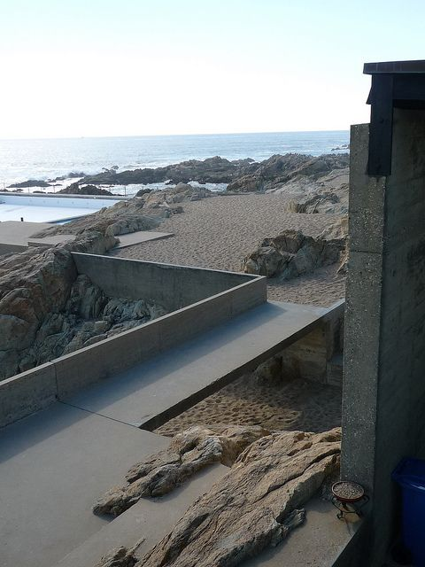 natural stone integrated into decking . Alvaro Siza, Leça Swimming Pools by Nancy Stieber, via Flickr