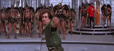 A gif from the cult film Flash Gordon (1980) with Tim as Prince Barin and Sam J Jones as Flash