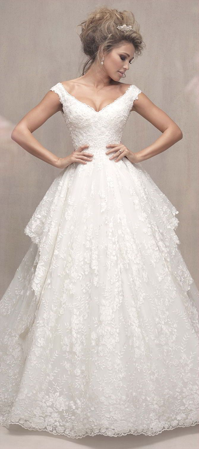 Side panels add dimension to this romantic, floral lace ballgown.