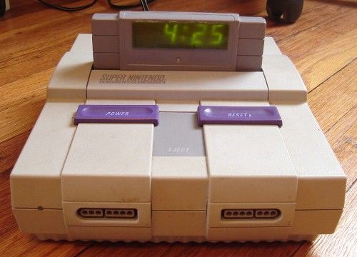 Don't throw away your old and broken NES! Turn it into an alarm clock instead.