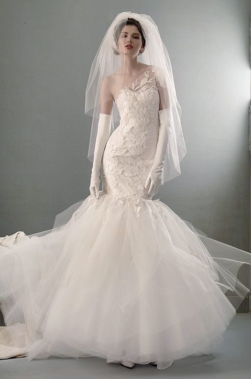 A gorgeous fingertip length, two-tiered wedding veil from the St.Pucchi 2014 Collection.    Colin Cowie Weddings