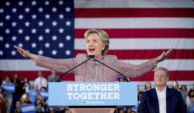 Top 10 Hillary Clinton scandals exposed by WikiLeaks - Washington Times - Democratic presidential candidate Hillary Clinton, accompanied by former Vice President Al Gore, right, attempts to quiet the crowd as a protester disrupts her speech during a rally at Miami Dade College in Miami, Tuesday, Oct. 11, 2016. (AP Photo/Andrew Harnik)