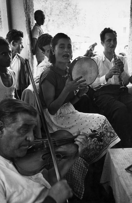 David Seymour - Olympia. GREECE. 1951. At the full moon in September, the traditional time for ancient Olympic games, a panegyreis (county fair) takes place. Every tavern hires an orchestra for the occasion. This one has a gypsy singer and dancer.