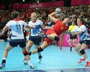 Bojana Popovic of Montenegro scores a goal in the Women's Handball