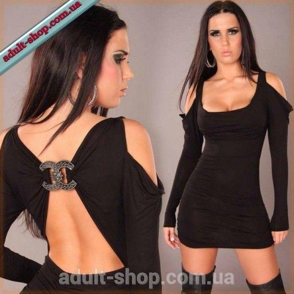 Черное мини платье с вырезами и вброшью на спине.