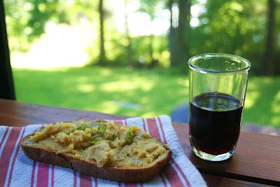 Schmear of English caramelized onion cheddar on fantastic artisan bread with red wine.  Life. is. good.