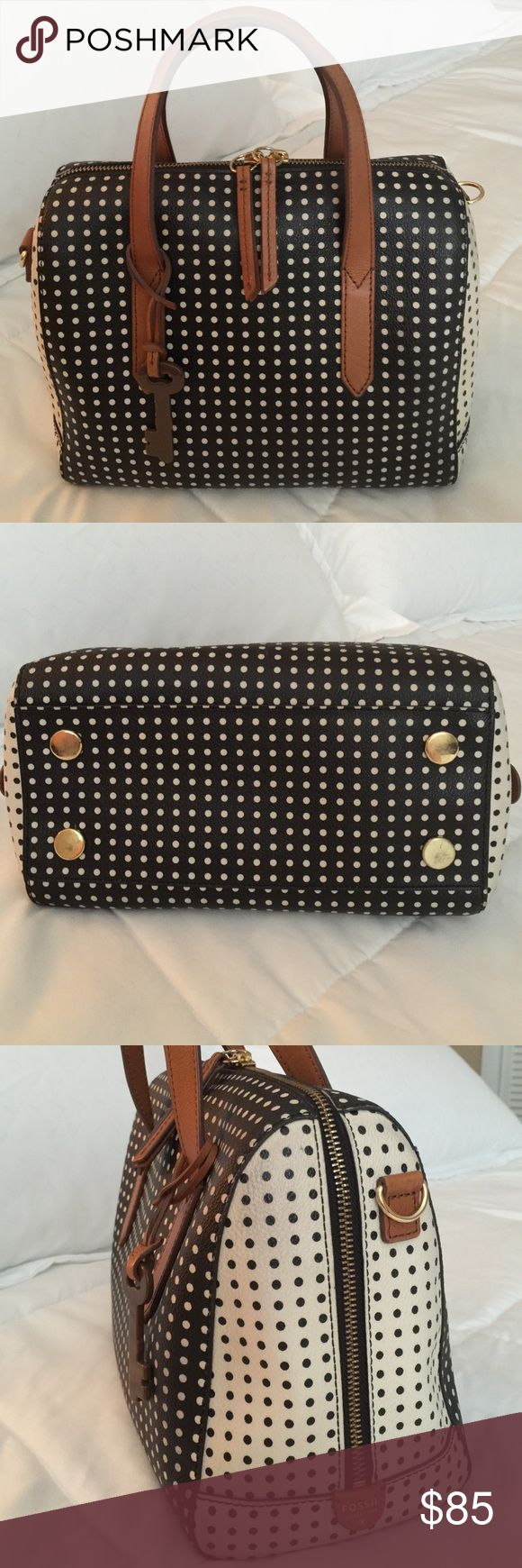 """Fossil polka dot Sydney satchel This super cute great quality fossil bag is gently used with minor wear - very clean, smoke free with no rips or tears. I used it without the strap so i don't have it anymore.  There is a small 1/2"""" pen mark which is inside and you can see it in pic. Black and off white polka dots with gold hardware. Fossil Bags Satchels"""