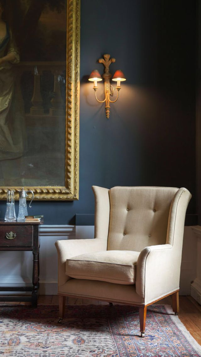 The Theodore Chair is a contemporary take on a classic chair. It has a high wing design and combines elegant lines with particularly comfortable head and neck support. Shown in Bantry Linen - Dark Honey.