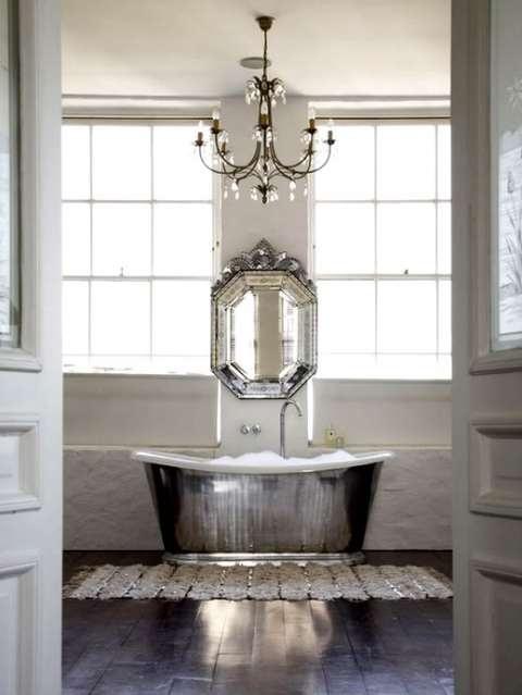 awesome antique mirror with silver bathtub in a bathroom