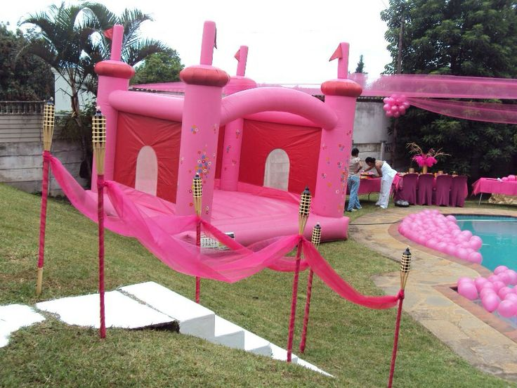 Pink jumping castle, balloons