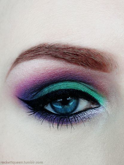 Bold color choices in eye makeup. Love the jewel tones.