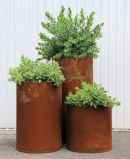 Large (2-3 ft) corten steel planters for ferns and Saxifraga. Goes with metal of…