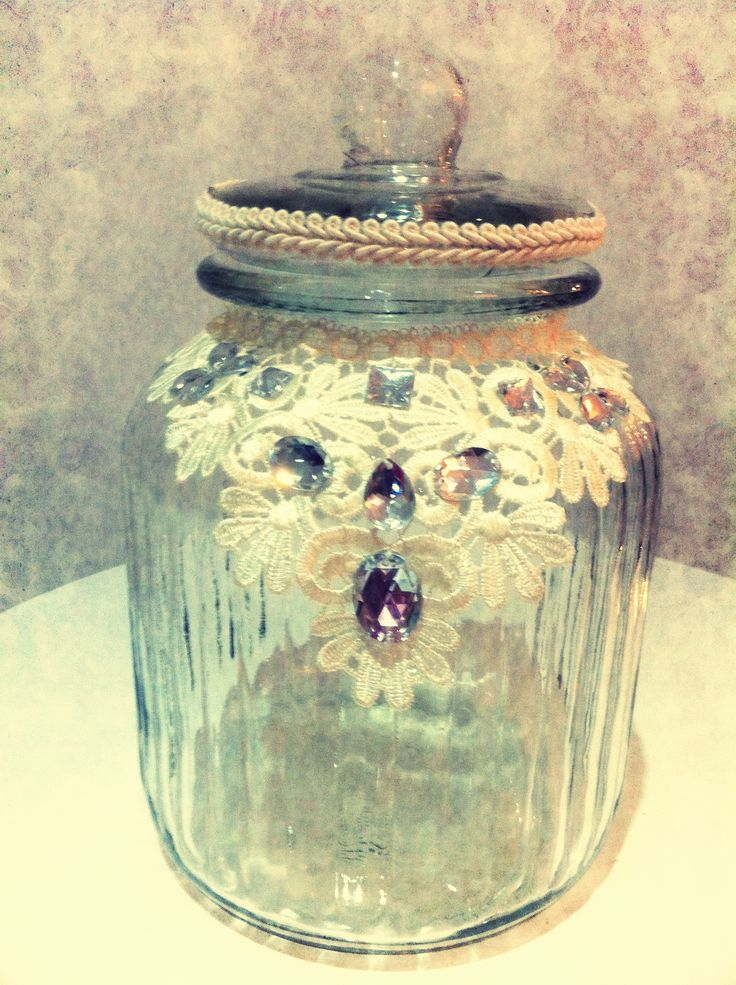 purchased a large jar from a cheap shop for $6 added an old lace necklace from Diva add a little lace and wow :)