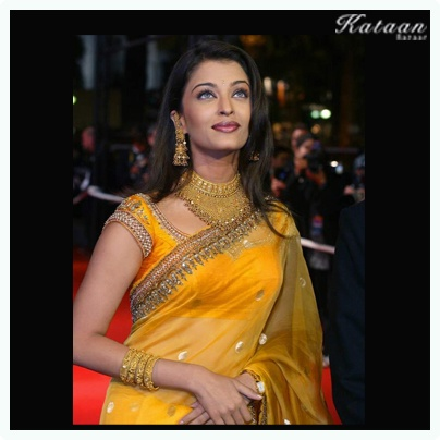 #Aishwarya Rai flaunting a traditional look in a YELLOW saree