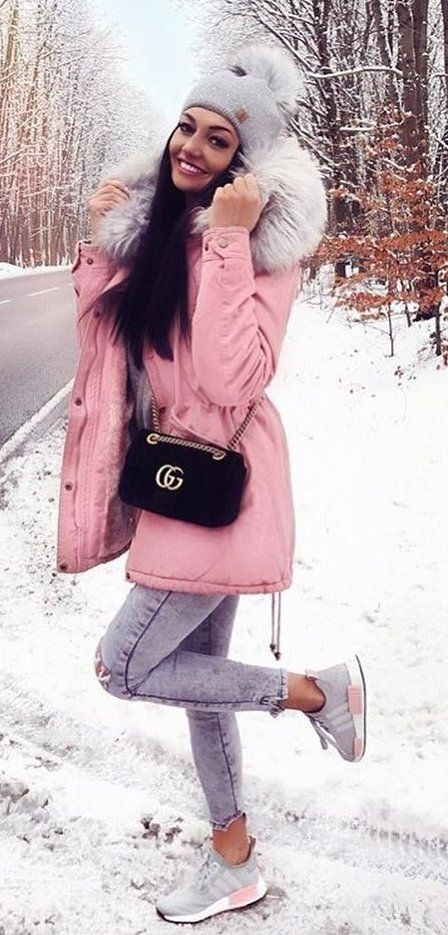 #winter #outfits pink and white trench coat and bubble hat; distress gray skinny jeans; black Guess crossbody bag; pair of gray Adidas NMD_R1 shoes