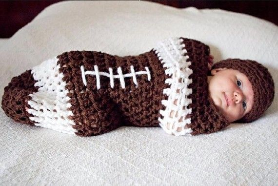 This adorable brown and white newborn NFL football cocoon and hat set is made from a super soft acrylic yarn. I have crocheted the cocoon in a looser stitch so that babies little bits and pieces can p