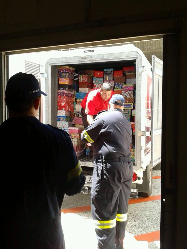 The Cape Town Fire Department assisting Stor-Age with the unpacking of Santa Shoebox boxes at the CTICC
