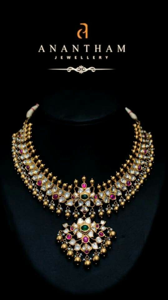 Kundan necklace with ruby and emerald suspended with gold beads by Anantham Jewellers