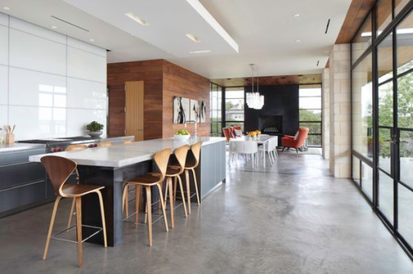 Long and spacious kitchen featuring concrete floors and floor-to-ceiling windows