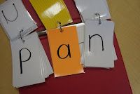 So easy and cheap to do! Blending Books - 3 ring binder, index cards. Consonants on white, vowels on a color.