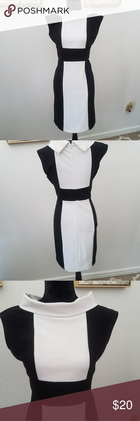 London Times, sleeveless black and white dress. Very cute, London Times black and white knit dress. It's a 8 petite. In very good condition. London Times Dresses