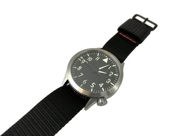 """NSN : Pending * Free Black Mil Series 20mmBand & Black Watch Taco * Limited Run 200 Pieces The Maratac™ Pilot SwissQuartzwatch was privately contracted for a local agency. The second hand sweeps like a mechanical watch at 1/4 second increments, for more of a """"fluid sweep"""". The watch features a central second sweep hand. The watch features a sterile clean dial, with no date and no branding. This watch is made to exemplify the purest form of time which provides a simplistic feel to th..."""