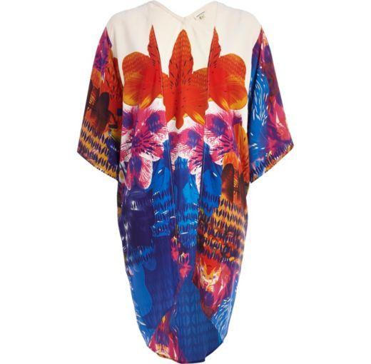 I'm shopping White oversized flower print kimono in the River Island iPhone app.
