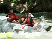 Classic Family Rafting in Western NC  North Carolina's shimmering Nantahala River offers river rafting through family-friendly rapids that are mild but exciting. The Nantahala features eight miles of practice on easy Class II rapids before splashing through the exciting Class III whitewater of Nantahala Falls. This is one of America's most popular whitewater runs!
