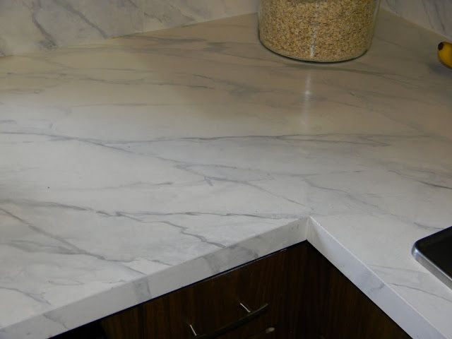 Tutorial: How to paint formica countertop to look like marble! According to the blogger, it holds up well and cleans easily with magic eraser. (This DIY looks difficult though.)