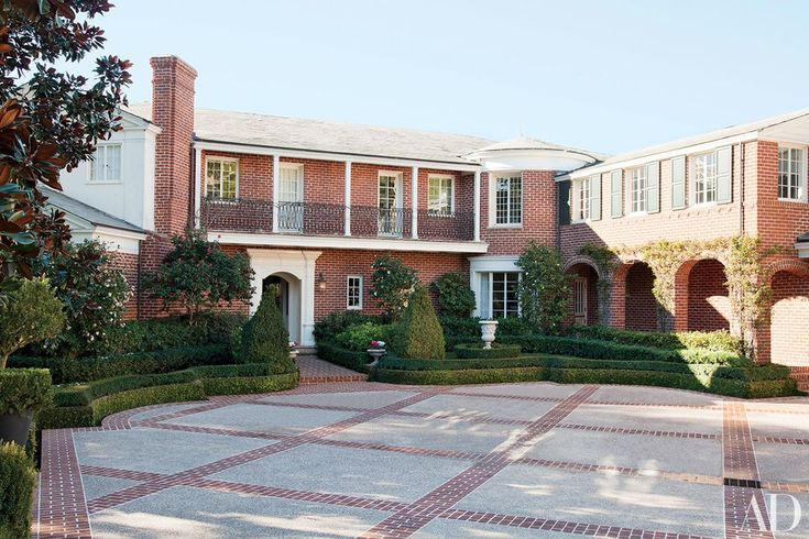 The front façade of Steve Tisch's 1932 Paul Williams house turns away from the property's sweeping views of Los Angeles and toward an expansive driveway.