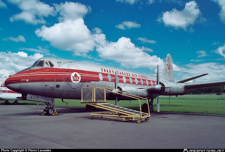 Trans Canada Airlines Viscount parked outside the hanger before towing to Ramp. Work stand with manual hydraulic pump standing by.