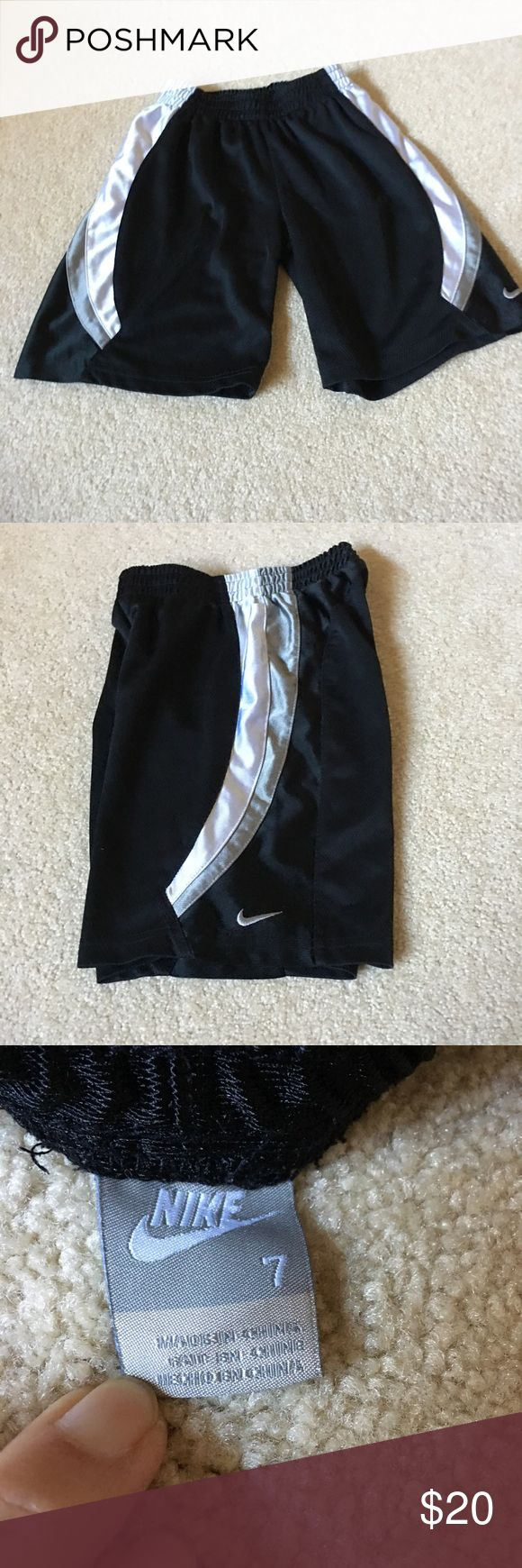 NIKE basketball shorts - 7 EUC. NIKE black with white and gray basketball shorts. Size 7. Elastic waist. No pockets. Nike Bottoms Shorts