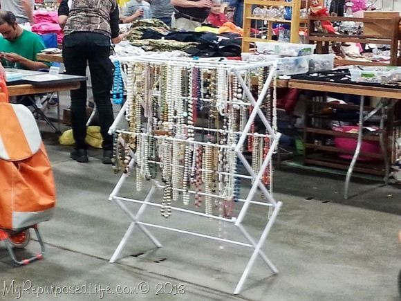 """Jewelry display at a craft show. What a great idea for jewelry! Also - belts, scarves, bags, etc.great for my bags.  """"S"""" hooks over the rails for some items, maybe foot braces to help keep it from tipping over."""