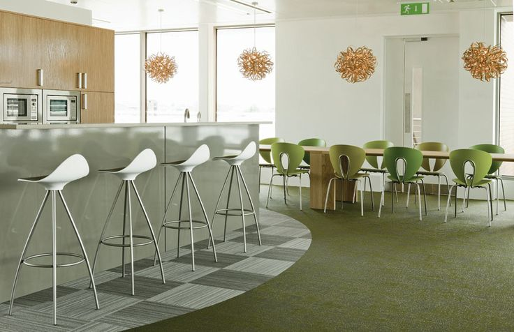 The offices of Publicis in Dublin have been furnished using STUA designs. This is the kithcen are with Onda stools and Globus chairs.