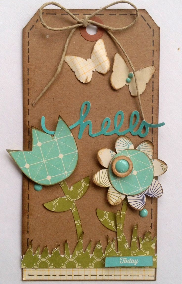 Hello | Jillibean Soup - Scrapbook.com - Paper piece flowers, grass and butterflies for a pretty homemade tag.