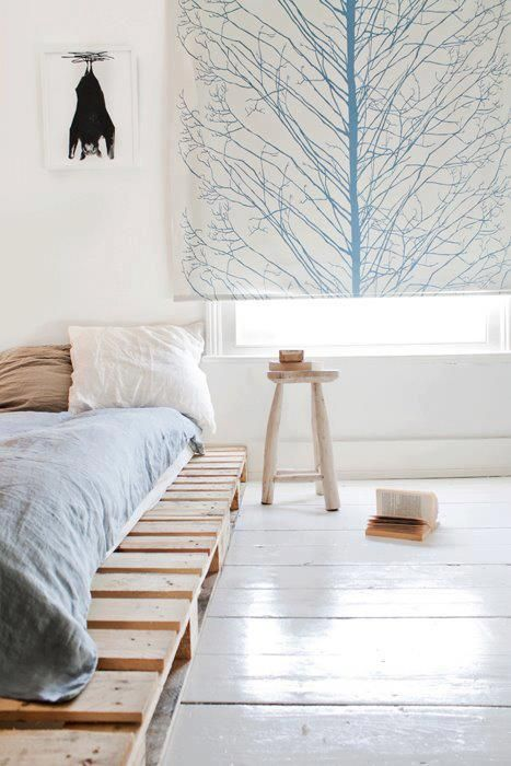 pallet bed platform, white wood floors, painted roller shade, stool as night stand