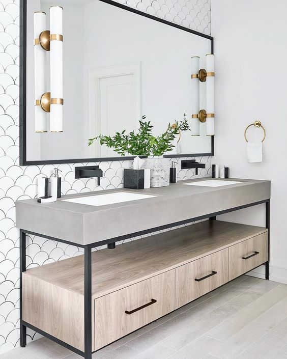 Custom vanity ✔️ scalloped wall tiles ✔️ custom mirror ✔️ porcelain wood floors ✔️ mixed metals ✔️ black and white marble accessories ✔️ adding an entire 3rd floor to make this happen ✔️ fresh, chic, spa vibes ✔️ .  .  .  #alibuddinteriors #interiordesign #masterbathstyle #bespoke #mixedmetals #mixedmaterials #detailsdetails @stephanibuchmanphoto