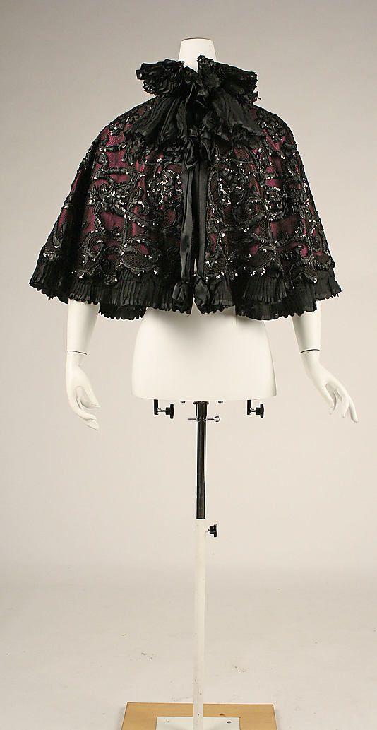 Cape Au Louvre (French)  Date:     ca. 1897 Culture:     French Medium:     silk, cellulous nitrate, gelatin, glass