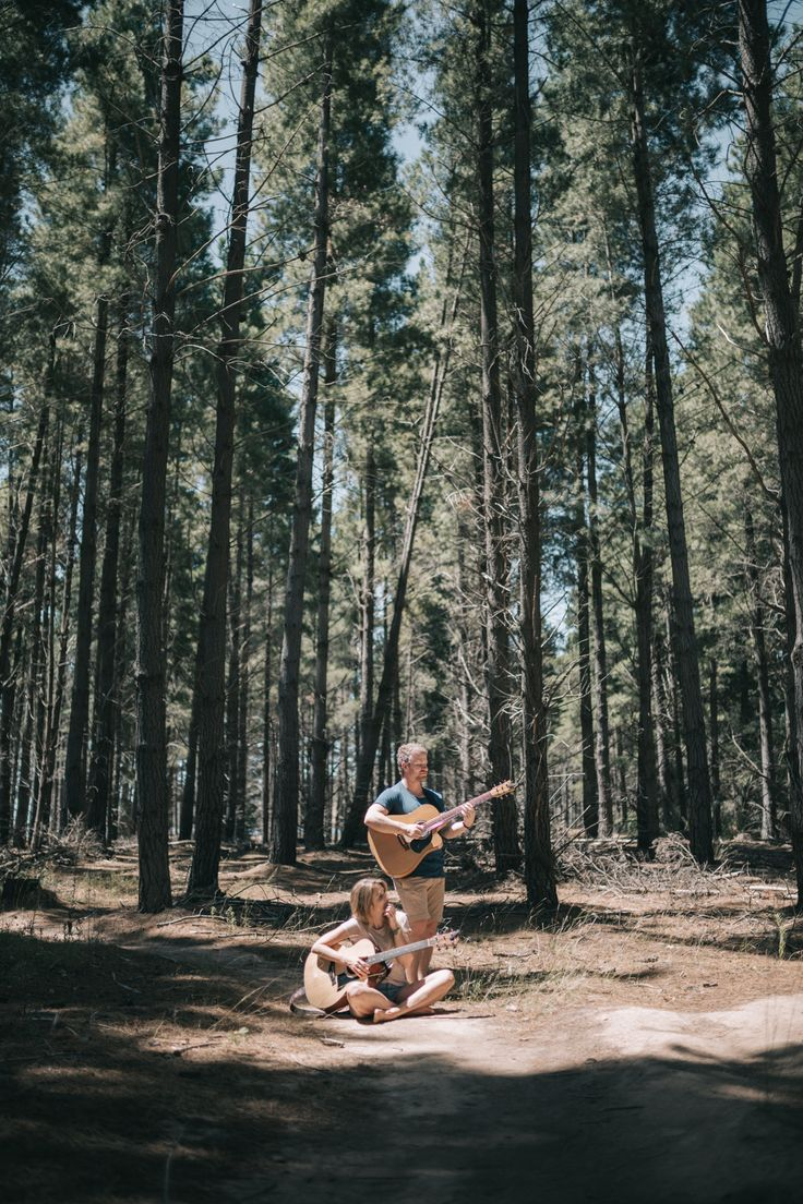 Male and female musician sat in the forest together with their guitars – Canberra, ACT, Australia