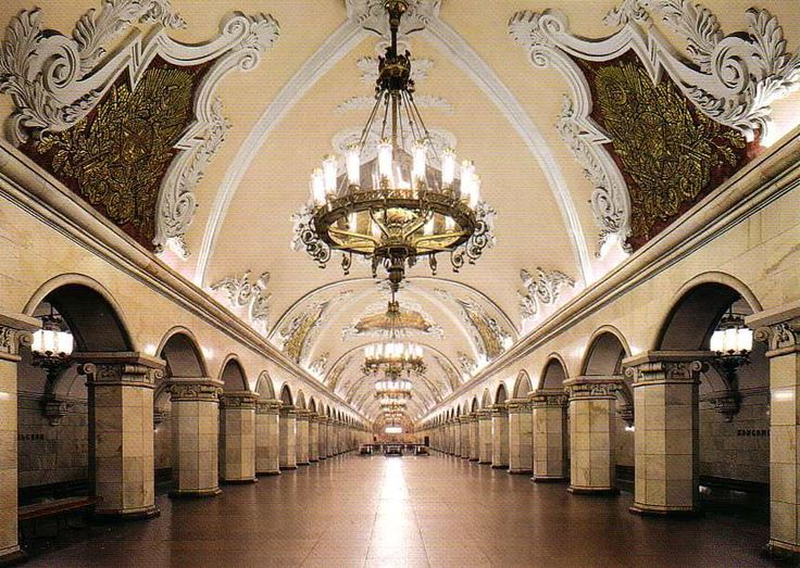 """Dubbed """"thepeople's palaces"""", the Moscow metro is, by far, the most ornately decorated transportation system in theworld. It is a monument to the totalitarian epoch, filled with shining examples of Soviet art and style. The décor includes bronze sculpture, Florentine mosaics, frescoed ceilings, chandeliers, art nouveau benches, stained glass and ceramics."""