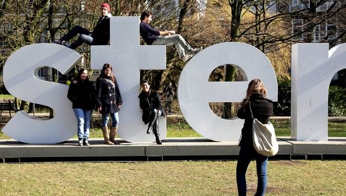 Have your photo taken on the I amsterdam letters outside Rijksmuseum http://www.iamsterdam.com/en/visiting/what-to-do/top-20-things-to-do-in-amsterdam