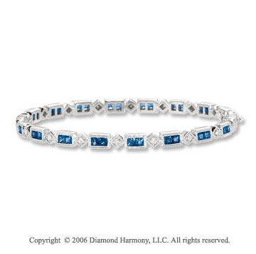 14k White Gold Princess Blue Sapphire Diamond Bangle Bracelet -> Description: This gorgeous bangle has pave set round diamonds alternating with channel set princess blue sapphires. You must experience the beauty of this 14k WG Princess Blue Sapphire Diamond Bangle Bracelet. -> sku=BG1076 -> Price $1340.00