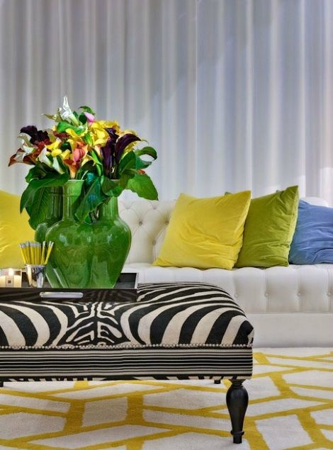 living room with white sofa and yellow green blue pillows