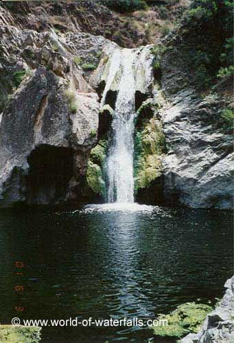 Paradise Falls seen from an angle partially obstructed by a rock, Wildwood Park / Thousand Oaks / Ventura County, California, USA