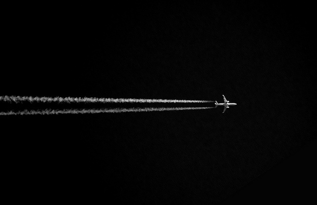 Minimalism, airplane in dark sky