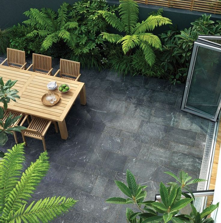 Terrace tiles made of natural stone enhance the outdoor area