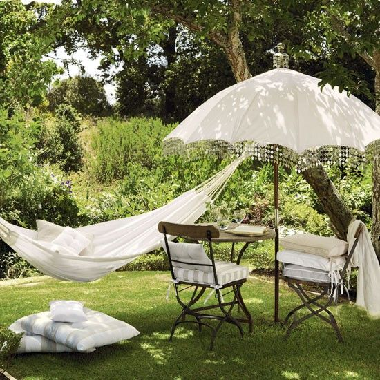 Vintage-style garden    Neutral cottons and linens in pale greys, beiges and whites create a calm feel for a garden sanctuary.    Hammock, parasol and cushions  The White Company  Similar furniture  Tesco direct